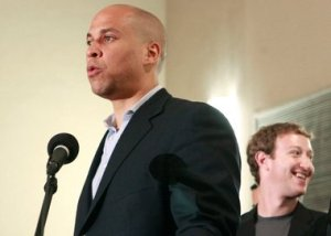 Cory Booker (left) and Mark Zuckerberg