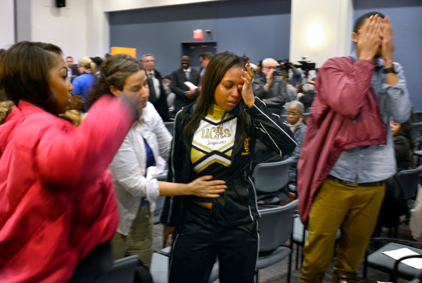 Students and staff members from University City High School in Philadelphia reacted to news that their school was closing.