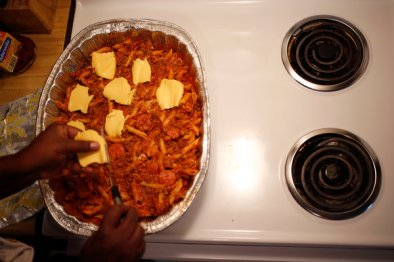 """We don't splurge,"" Ms. Adams said, ""and it doesn't last."" She shops at Save-A-Lot and cooks frequently with pasta, because it is filling. One recent evening, she baked a tray of mostaccioli, an Italian pasta, with meat and cheese. Hoping it would last for two meals, she had none herself. ""You hate to tell your child, 'You can't eat this, you have to save it for another day,' "" she said."