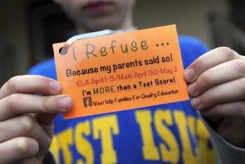 "In some New York (Long Island) school district, organized Opt Out movement families are providing their children with a lanyard indicating that they are opting out of the ""ELA"" tests (see above). In addition to informing the schools that they want to opt out their children, the parents are making double certain that the schools and others get the message."