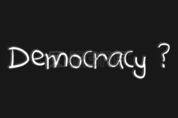 democracy-text-with-blackgroun-and-question-mark-sign