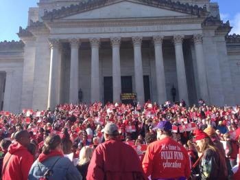 Teachers on the steps at the Capital Building in Olympia, WA on April 25, 2015