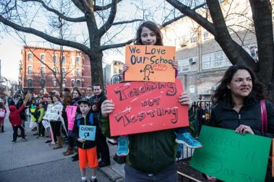Jessie Rothenberg, age 8, holds a sign while sitting on her father's shoulders while protesting Gov. Cuomo's education policies in Park Slope, Brooklyn, in March.