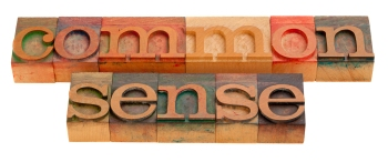 common sense - words in vintage wooden letterpress printing blocks isolated on white