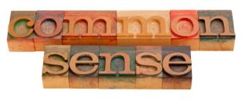common sense - words in vintage wooden letterpress printing blocks isolated on white