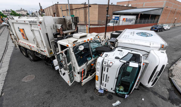 two garbage trucks colliding